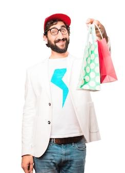 Jonge gekke zakenman met boodschappentassen