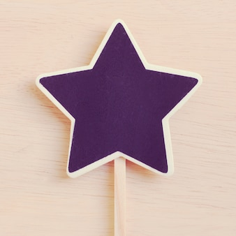 Star shape blackboard op hout met retro filter effect