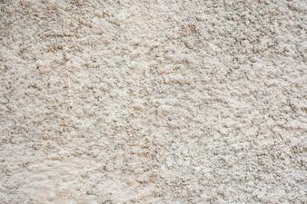 Textuur van de muur met korrels