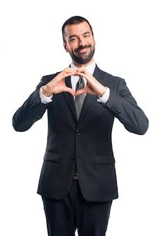 Zakenman maken een hart met zijn handen