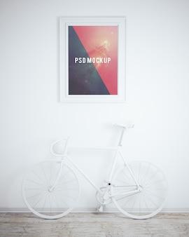 Frame op witte muur met witte fiets mock up