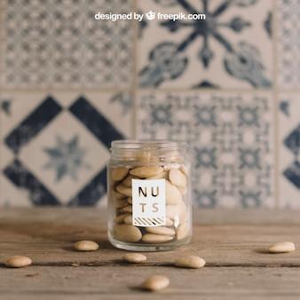 Mockup van noten in glas