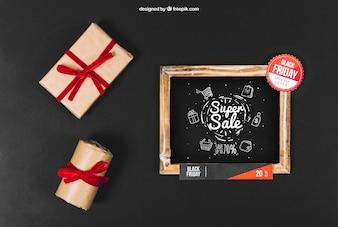 Zwarte vrijdag mockup met leisteen en cadeau dozen