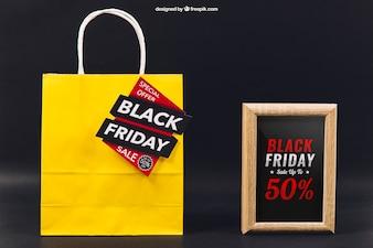 Zwarte vrijdag mockup met tas en frame