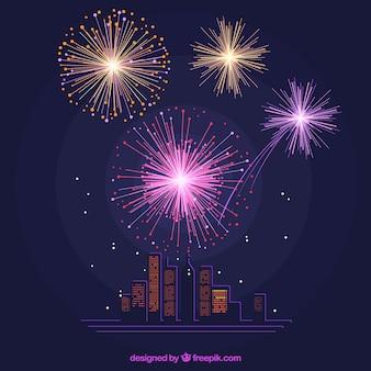 Achtergrond van gebouwen verlicht door vuurwerk