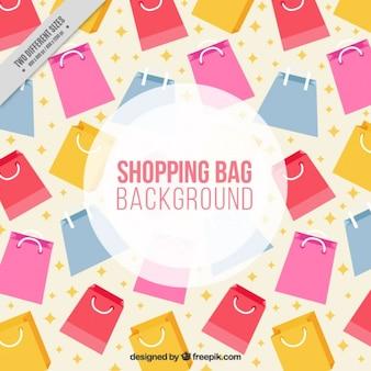 Achtergrond van gekleurde boodschappentassen in plat design