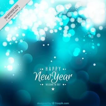Blauwe glanzende nieuwe jaar achtergrond
