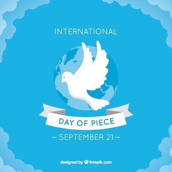 Blauwe vrededag achtergrond met witte duif