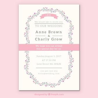 Bloemen trouwuitnodiging met roze details