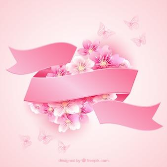 Bloesems van de kers met een roze lint