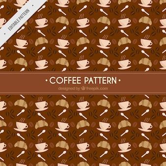 Brown patroon met croissants en koffiekoppen