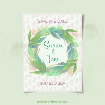 Bruiloft uitnodiging met groene krans