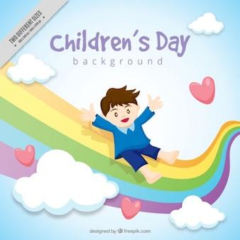 Creatieve achtergrond van de jongen met een regenboog