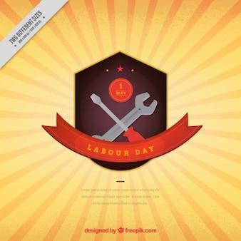 Dag van de Arbeid badge op een zonnestraalachtergrond