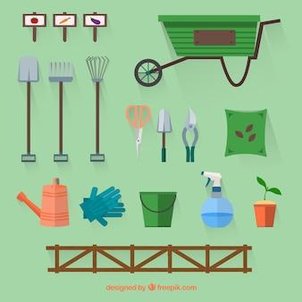 De collectie van nuttige tuinaccessoires in plat design