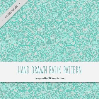 De hand getekende bloemen sier batik patroon