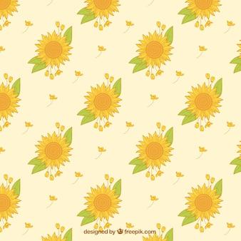 Decoratief patroon van zonnebloemen en de hand getekende bladeren