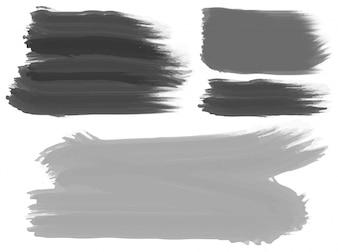 Drie penseelstreken in zwart en grijs