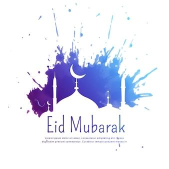 Eid mubarak groet met blauwe inkt splatter en moskee silhouet