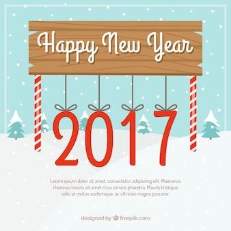 Gelukkig Nieuwjaar bord met opknoping zuurstokken