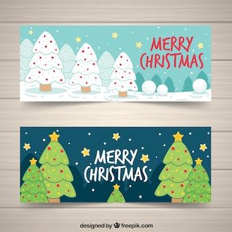 Gelukkige kerstbanners met handgetekende bomen