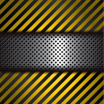 Geperforeerde metalen achtergrond met gele en zwarte strepen waarschuwing
