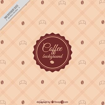 Geruite achtergrond met koffiebonen en croissants