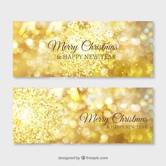 Golden glanzende banners voor vrolijke Kerstmis en Nieuwjaar