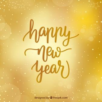Gouden nieuwjaar achtergrond met wazige stijl