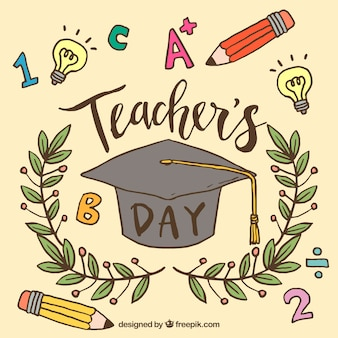 Graduate cap, krans en potloden op een beige achtergrond