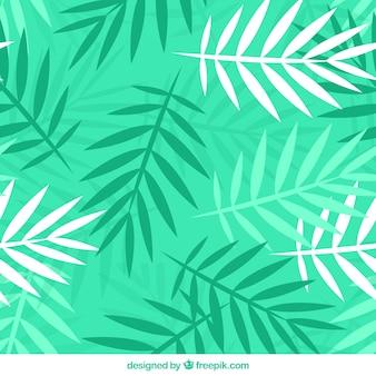 Groen patroon met palmbladeren in vlakke vormgeving