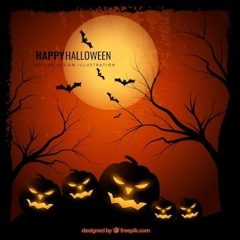 Grunge halloween kaart met griezelige pompoen