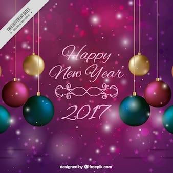 Heldere paarse achtergrond kerstballen van het nieuwe jaar