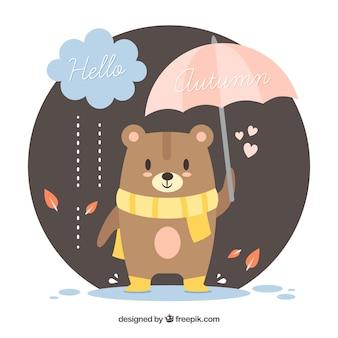 Herfst achtergrond met schattige beer met sjaal en paraplu