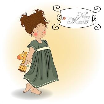 Jong meisje gaat naar bed met haar favoriete girafstuk speelgoed
