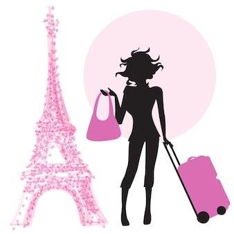 Jonge vrouw met koffer in Parijs