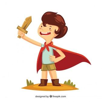 Jongen met een houten zwaard en een cape