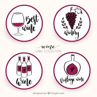 Met de hand getekende collectie van vier ronde wijnetiketten