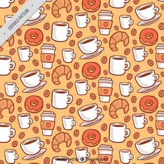 Met de hand getekende patroon met koffiemokken en snoep