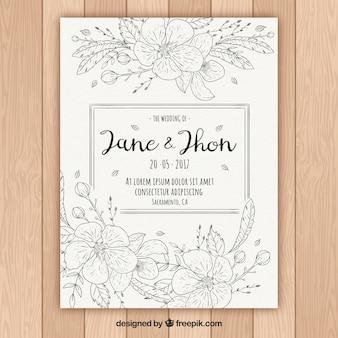 Met de hand getekende sjabloon van bloemen bruiloft uitnodiging
