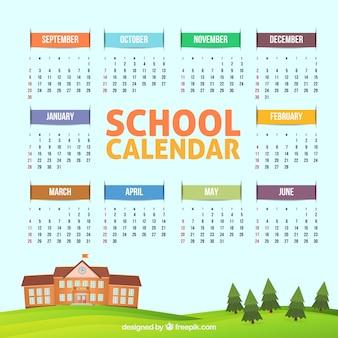 Mooie school kalender met schoolgebouw en bomen