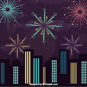 Nacht stadslandschap met vuurwerk en gebouwen