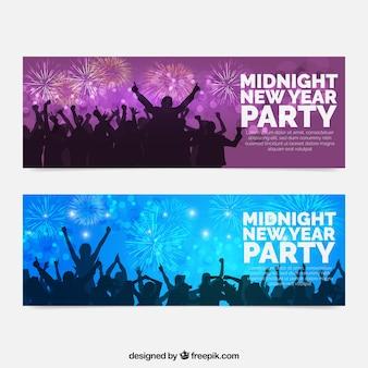 New year banners met silhouetten en vuurwerk