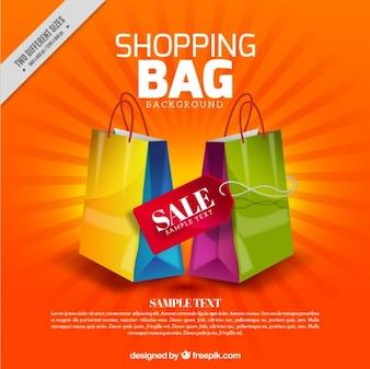 Oranje achtergrond van kleurrijke verkoop boodschappentassen