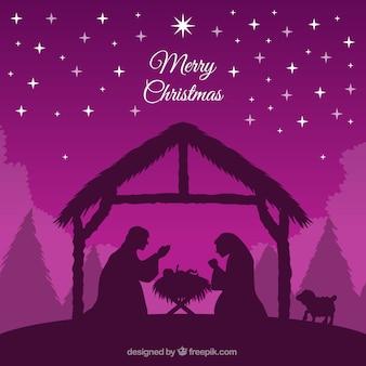 Paarse achtergrond van de kerststal silhouet