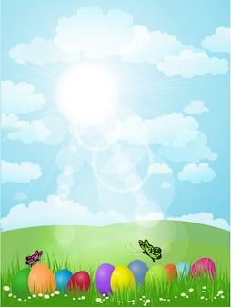 Paaseieren in het gras met vlinders en een zonnig landschap