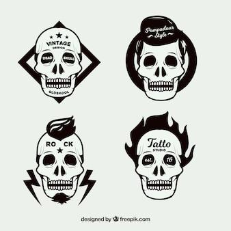 Pakje van vier schedel logo's in plat design