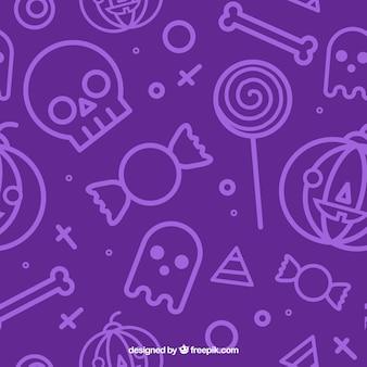 Patroon met paarse achtergrond en Halloween elementen