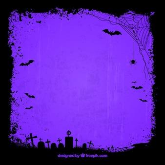 Purpere achtergrond met silhouetten van graven en spinnenweb