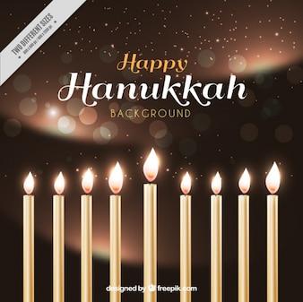Realistische hanukkah achtergrond met kaarsen en bokeh effect